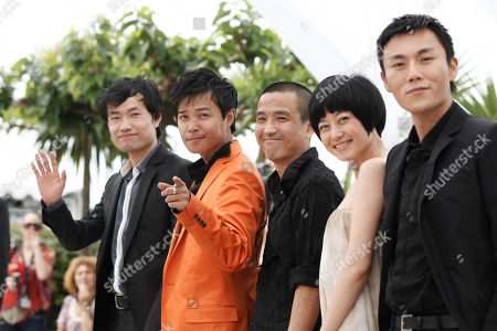 Stock Photo of Hao Qin, Zhuo Tan, Sicheng Chen, Lou Ye, Wei Wu Hao Qin, right, Zhuo Tan, second from right, Chinese director Lou Ye, center, Sicheng Chen, second from left, and Wei Wu, left, are seen during a photo call for the film 'Chun Feng Chen Zui De Ye Wan' (Spring Fever), during the 62nd International film festival in Cannes, southern France