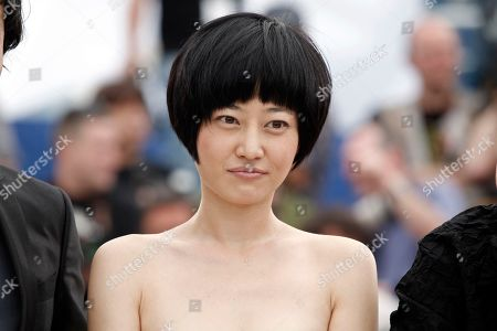Zhuo Tan Chinese actress Zhuo Tan poses for photographers during a photo call for the film 'Chun Feng Chen Zui De Ye Wan' (Spring Fever), during the 62nd International film festival in Cannes, southern France