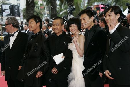 Lou Ye, Hao Qin, Zhuo Tan, Sicheng Chen, Wei Wu Chinese Director Lou Ye, third left, arrives with cast members from right, Wei Wu, Hao Qin, Zhuo Tan, and Sicheng Chen for the screening of 'Chun Feng Chen Zui De Ye Wan' (Spring Fever) during the 62nd International film festival in Cannes, southern France