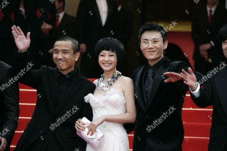 Stock Image of Hao Qin, Zhuo Tan, Lou Ye Chinese director Lou Ye, left, arrives with cast members Zhuo Tan, center, and Hao Qin, right, for the screening of their film 'Chun Feng Chen Zui De Ye Wan' (Spring Fever) at the 62nd International film festival in Cannes, southern France