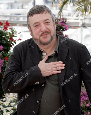 Stock Image of Pavel Lounguine Russian director Pavel Lounguine gestures as he attends a photo call for the film 'Tzar' during the 62nd International film festival in Cannes, southern France