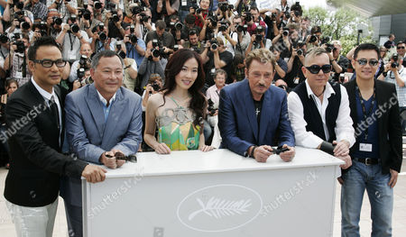 Simon Yam, Johnnie To, Johnny Hallyday, Anthony Wong Chinese actor Simon Yam, left, Chinese director Johnnie To, second from left, Chinese actor Michelle Ye, center, French actor and singer Johnny Hallyday, third from left, and Chinese actor Anthony Wong, second from right, pose during a photo call for the film 'Vengeance', during the 62nd International film festival in Cannes, southern France