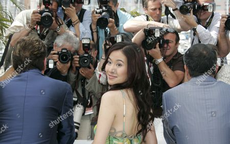 Michelle Ye Chinese actress Michelle Ye poses during a photo call for the film 'Vengeance' at the 62nd International film festival in Cannes, southern France, . Man at left is unidentified