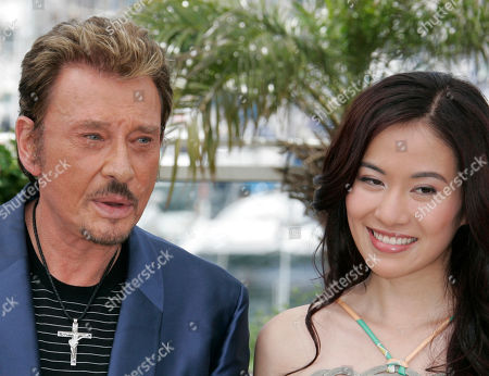 Johnny Hallyday, Michelle Ye Chinese actress Michelle Ye, right, and French actor Johnny Hallyday pose during a photo call for the film 'Vengeance' at the 62nd International film festival in Cannes, southern France, . Man at left is unidentified