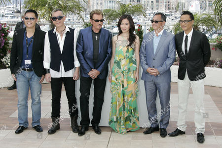 Simon Yam, Johnny Hallyday, Johnnie To, Michelle Ye, Anthony Wong From right, Chinese actor Simon Yam, Chinese director Johnnie To, Chinese actor Michelle Ye, French actor Johnny Hallyday, and Chinese actor Anthony Wong pose during a photo call for the film 'Vengeance' at the 62nd International film festival in Cannes, southern France, . Man at left is unidentified