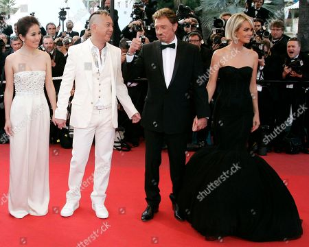 Johnny Hallyday, Laeticia Hallyday, Michelle Ye, Anthony Wong From left, Chinese actors Michelle Ye, and Anthony Wong, along with French actor Johnny Hallyday and his wife Laeticia arrive for the screening of the film 'Vengeance' at the 62nd International film festival in Cannes, southern France