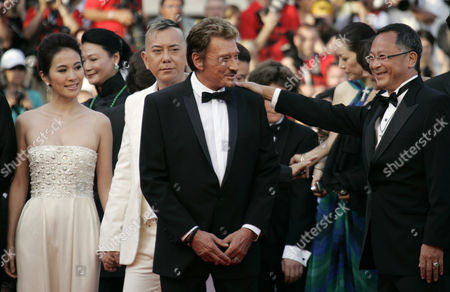 Johnnie To, Anthony Wong, Michelle Ye, Johnny Hallyday Chinese director Johnnie To, right, French actor Johnny Hallyday, second from right, Chinese actor Anthony Wong, second from left, and Chinese actor Michelle Ye, left, arrive on the red carpet for the screening of the film 'Vengeance', during the 62nd International film festival in Cannes, southern France