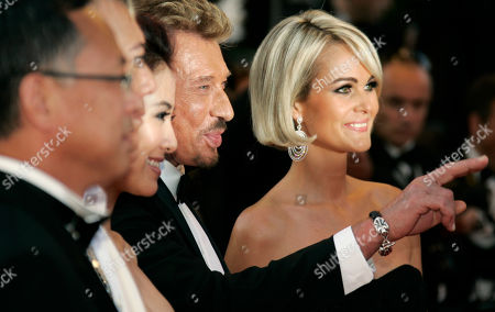 Michelle Ye, Johnny Hallyday, Laeticia Hallyday Chinese actor Michelle Ye, third from right, French actor Johnny Hallyday, second from right, and his wife Laeticia, right, arrive on the red carpet for the screening of 'Vengeance', during the 62nd International film festival in Cannes, southern France