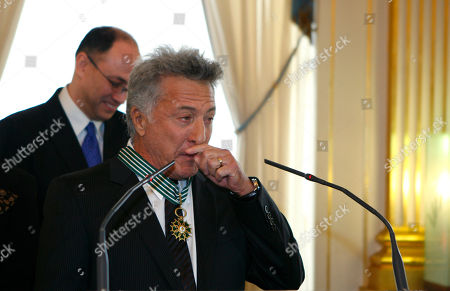 Dustin Hoffman U.S. actor Dustin Hoffman reacts after being awarded with the medal of Commander in the French Order of Arts and Literature by French Culture Minister Christine Albanel, unseen, during a ceremony at the Culture ministry in Paris
