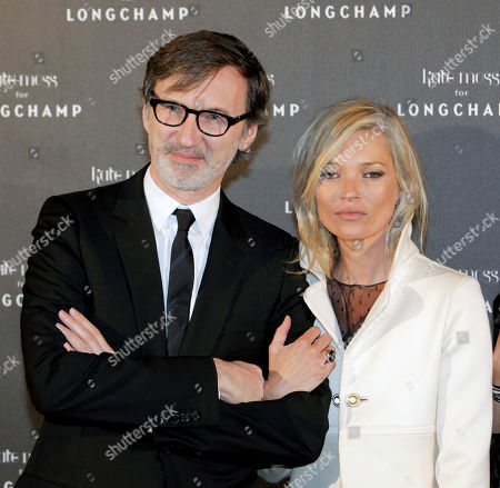 Kate Moss, Jean Cassegrain French luxury leather goods brand Longchamp CEO Jean Cassgrain, left, poses with British model Kate Moss, right, prior to a presentation of a new collection of Longchamp's bag that she designed, in Paris