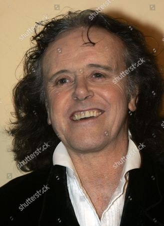 "Donovan Scottish singer-songwriter and guitarist Donovan gestures before receiving The Award of ""Officer of Arts and Letters"" from the French Minister of Culture and Communication, Christine Albanel during the 43rd MIDEM (International record music publishing and video music market) in Cannes, southern France"