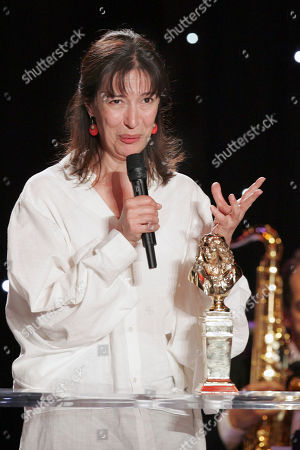 """Anne Alvaro French actress Anne Alvaro reacts after receiving the best female actress award for his part in """"Le cri' during the 23rd Molieres theatre award ceremony . in Paris"""