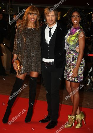 David Guetta, Cathy, Kelly Rowland French house producer and DJ David Guetta, center, with his wife Cathy, left, and American singer Kelly Rowland arrive at the Cannes festival palace, to take part in the NRJ Music awards ceremony, in Cannes, southeastern France