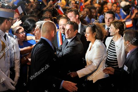 Nicolas Sarkozy, Marie-Luce Penchard, Chantal Jouanno French President Nicolas Sarkozy, center, followed by French Minister for Overseas Territories Marie-Luce Penchard, front third right, and French Ecology, Energy and Sustainable Development Junior Minister, Chantal Jouanno, second right, is greeted by officials and supporters after his arrival at the Pierrefonds airport outside Saint-Pierre, on the French overseas Reunion Island, . Sarkozy started Monday a two-day visit to the French overseas islands of Mayotte and La Reunion