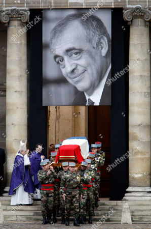French army soldiers carry the coffin of former minister and parliament speaker Philippe Seguin outside Saint-Louis des Invalides church in Paris during his funeral ceremony in Paris, . Philippe Seguin died at the age of 66 of a heart attack