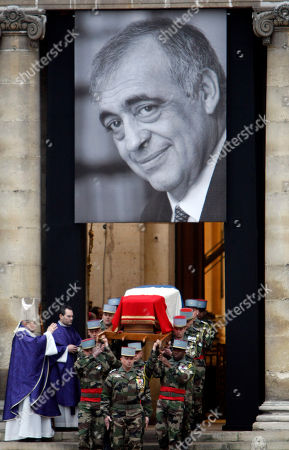 Paris bishop Andre Ving-Trois, left, blesses the coffin of former minister and parliament speaker Philippe Seguin outside Saint-Louis des Invalides church in Paris during his funeral ceremony in Paris, . Philippe Seguin died at the age of 66 of a heart attack