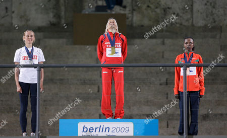 Marta Dominguez, Yuliya Zarudneva, Milcah Chemos Cheywa Gold medal winner Marta Dominguez of Spain is flanked by silver medal winner Yuliya Zarudneva, left, of Russia and bronze medal winner Milcah Chemos Cheywa of Kenza during the medal ceremony for the Women's 3000m Steeplechase during the World Athletics Championships in Berlin on