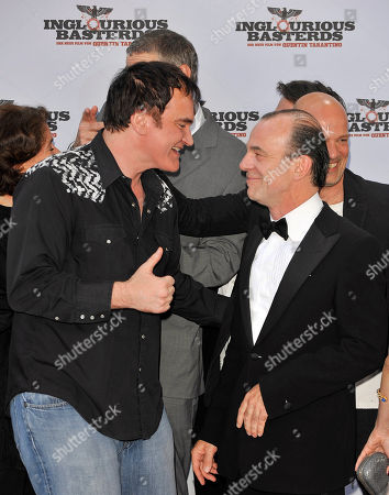 Quentin Tarantino, Martin Wuttke Director Quentin Tarantino, left, and actor Martin Wuttke arrive for the German premiere of the movie Inglourious Basterds in Berlin, Germany
