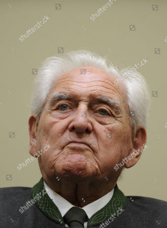 Stock Photo of Josef Scheungraber In this Aug. 11, 2009 file picture defendant Josef Scheungraber waits prior to the last day of his trial in a room of the court in Munich, southern Germany. The former German army officer convicted of ordering a wartime massacre of Italian civilians says he is in too poor health to serve time in jail. Barbara Stockinger, a spokeswoman for Munich prosecutor's office, said that doctors will now have to evaluate 92-year-old Josef Scheungraber to determine whether to allow him to remain free for health reasons