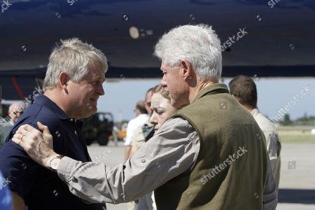 Denis O'Brien, Bill Clinton Digicel owner Denis O' Brien, left, talks with former U.S. President Bill Clinton, right, at the airport in Port-au-Prince, Haiti