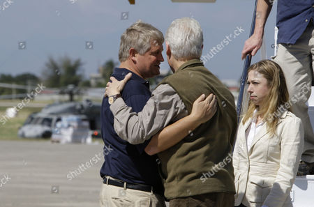 Denis O'Brien, Bill Clinton, Chelsea Clinton Digicel owner Denis O' Brien, left, talks with former U.S. President Bill Clinton, center, as Clinton's daughter Chelsea, right, looks on at the airport in Port-au-Prince, Haiti