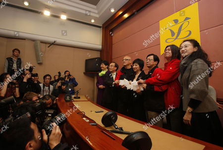 Stock Photo of Pauline Ng, Albert Chan, Alan Leong, Tanya Chan, Leung Kwok-hung, Wong Yuk-man Five Hong Kong legislators Tanya Chan, right, Leung Kwok-hung, second right, Wong Yuk-man, third right, Albert Chan, third left, Alan Leong, second left, present the resignation letter to Pauline Ng, center, Secretary General inside the Legislative Council in Hong Kong . The five legislators have resigned to pressure China for democracy in this semiautonomous former British colony. The lawmakers from the League of Social Democrats and Civic Party signed and held up their resignation letters for photographers Tuesday, then handed them to the secretary of Hong Kong's Legislative Council