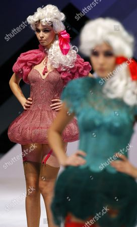 "A model displays a creation by Hong Kong designer Peter Lau during the show ""Knitwear Symphony 2010"" at the annual Hong Kong Fashion week, in Hong Kong"