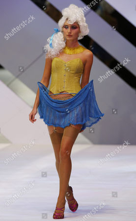 "Stock Image of A model displays a creation by Hong Kong designer Peter Lau during the show ""Knitwear Symphony 2010"" at the annual Hong Kong Fashion week, in Hong Kong"