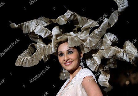 Miss India World 2009 Pooja Chopra, showcases a creation by Preeti Chandra during the second day of the Bangalore Fashion Week in Bangalore, India