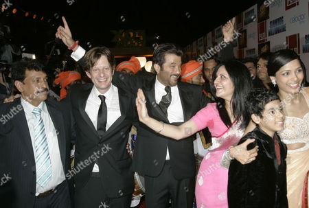"""Christian Coulson, Anil Kapoor, Loveleen Tandan, Freida Pinto Slumdog Millionaire' producer Christian Coulson, second left, actor Anil Kapoor, third left, co-director Loveleen Tandan, third right, and actor Freida Pinto, right dance as they arrive for the premiere in Mumbai, India, . India's film industry celebrated Thursday as """"Slumdog Millionaire"""" lived up to its rags-to-riches theme, receiving 10 Oscar nominations. The film, set amid the poverty of Mumbai's notorious slums, continued its surprise run of success since it swept its four categories at the Golden Globes, including the prize for best drama. The film got the second highest number of nominations, including best director for Danny Boyle, best picture and two of the three song slots"""