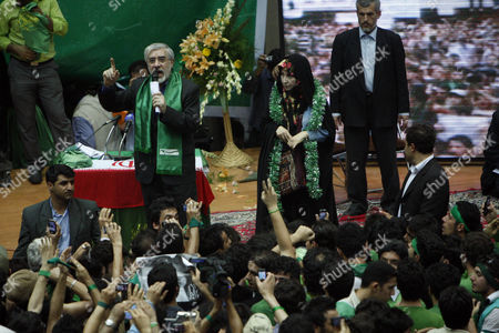 Leading reformist candidate in upcoming Iranian presidential elections, Mir Hossein Mousavi,left, speaks as his wife Zahra Rahnavard, right, looks, during a election campaign in Tehran . Mousavi, is a former Prime Minister, and a main challenger of the hard-line President Mahmoud Ahmadinejad for June 12 presidential elections