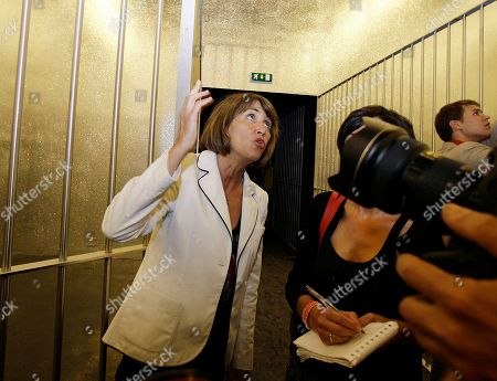 "Christine Albane France's Minister for Culture and Communication Christine Albanel looks at Claude Leveque' s installation ""Le Grand Soir"" at the French pavilion during the vernissage of the 53rd Biennale International Art Exhibition in Venice, Italy"