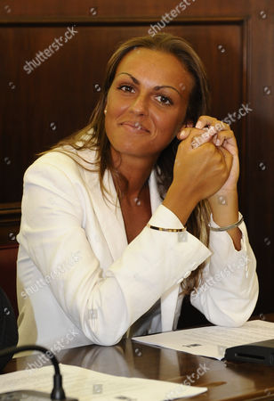 "This July 20, 2009 photo made available shows Francesca Pascale posing for photographers on the first day as People of Freedom party province of Naples council member, in Naples' Province palace, Italy. In a weekend interview, Berlusconi apologized for the ""bunga bunga"" parties, saying he was lonely after having split of with his second wife, Veronica Lario who left him in 2008, citing alleged dalliances with young women. He also revealed he is engaged to a woman almost 50 years his junior, and says that ""finally I feel less alone."" The 76-year-old media baron said Sunday his engagement to 28-year-old Francesca Pascale - part of a support group called ""Silvio, we miss you"" - is ""official"