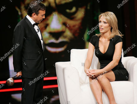 "Cori Rist listens to Piero Chiambretti as she makes an appearance at the ""Chiambretti night"" TV show to talk about her alleged affair with Tiger Woods, in Milan, Italy"