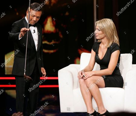 "Stock Photo of Cori Rist Cori Rist looks at a club held by anchorman Piero Chiambretti as she makes an appearance at the ""Chiambretti night"" TV show to talk about her alleged affair with Tiger Woods, in Milan, Italy"