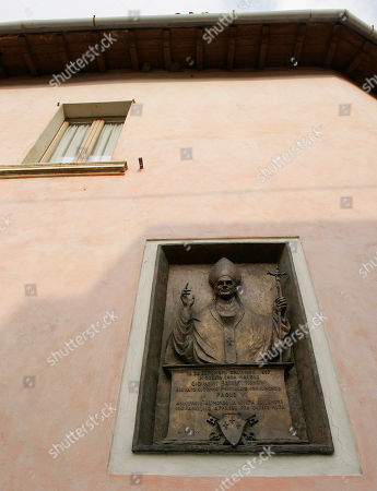A commemorative plaque on the external wall of the house where Giovanni Battista Montini, that later became Pope Paul VI, was born in Concesio, near Brescia, Italy, . Pope Benedict XVI will visit the house on Nov. 8, in a visit marking the 30th anniversary of his death
