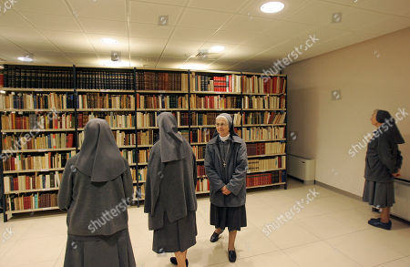 Stock Image of Nuns look at the library of Pope Paul VI inside the new building of the Institute Paul VI that will be inaugurated on Nov. 8, next to the house where Giovanni Battista Montini, that later became Pope Paul VI, was born in Concesio, near Brescia, Italy, . Pope Benedict XVI will visit the house on Nov. 8, in a visit marking the 30th anniversary of his death