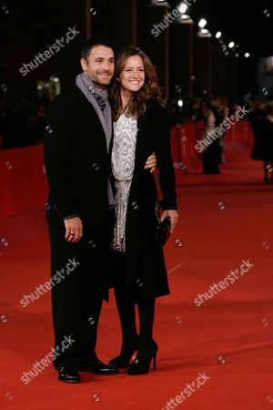 Raul Bova, Chiara Giordano Italian actor Raul Bova, left, and his wife Chiara Giordano pose on the red carpet at the 4th edition of the Rome Film Festival in Rome
