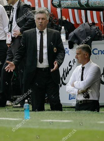 AC Milan coach Carlo Ancelotti, left, with his vice Mauro Tassotti during the Italian Serie A soccer match between AC Milan and AS Roma at the San Siro stadium in Milan, Italy