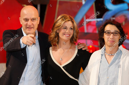 Claudio Bisio, Vanessa Incontrada and Paolo Iannacci pose for photographer during a presentation of 'Zelig 2010' Tv show, in Milan, Italy, Tuesday, Jan.12, 2010
