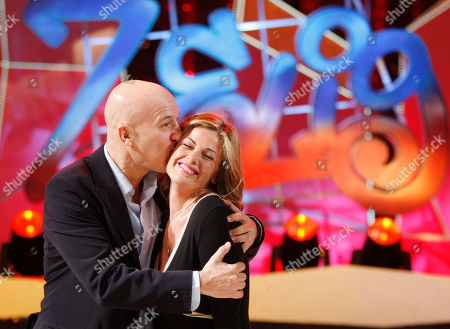 Claudio Bisio kisses Vanessa Incontrada as they pose for photographer during a presentation of 'Zelig 2010' Tv show, in Milan, Italy, Tuesday, Jan.12, 2010