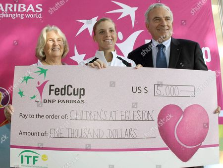 Lucy Garvin, Francesco Ricci Bitti, Melanie Oudin From left, president of the U.S. Tennis Federation Lucy Garvin, president of the Italian Tennis Federation Francesco Ricci Bitti and U.S. Fed Cup team's player Melanie Oudin are seen ahead of the Fed Cup tennis final between Italy and the United States, in Reggio Calabria, Italy