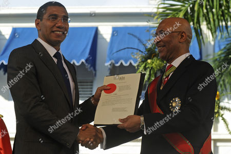 Andrew Holness, Sir Patrick Allen Andrew Holness, 39, left, shakes hands with Jamaica's Governor General Sir Patrick Allen during his swearing in ceremony as Jamaica's ninth prime minister in Kingston, Jamaica, . Holness, who has become the youngest leader in Jamaica's history in a seamless power transition for the Jamaica Labor Party, takes over from Bruce Golding, who officially stepped down Sunday after four years as prime minister. Holness will lead the party into general elections that must be held by December 2012