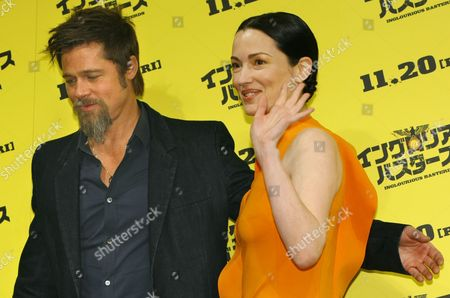 """Brad Pitt, Julie Dreyfus U.S. actor Brad Pitt, left, and French actress Julie Dreyfus poses for photographers before a press conference for their latest film """"Inglourious Basterds"""" in Tokyo, Japan"""