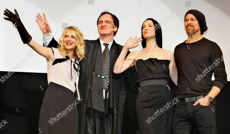 """Stock Picture of Brad Pitt, Quentin Tarantino, Melanie Laurent, Julie Dreyfus U.S. actor Brad Pitt, right, poses along side French actress Julie Dreyfus, second from right, U.S. director Quentin Tarantino, second from left, and French actress Melanie Laurent, left, during the Japan premiere of their film """"Inglourious Basterds"""" in Tokyo, Japan"""