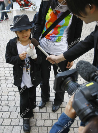 """Stock Image of Five-year-old Anna Tanaka answers an interview before Japan premiere of """"Michael Jackson's This is it"""" in Tokyo, Japan, . Jackson, 50 when he died last June, kept pace with backup dancers half his age during rehearsals for such hits as """"Thriller,"""" """"Billie Jean,"""" """"Beat It"""" and """"Human Nature."""" The film was shot as Jackson prepared for a marathon concert stand in London that never happened"""