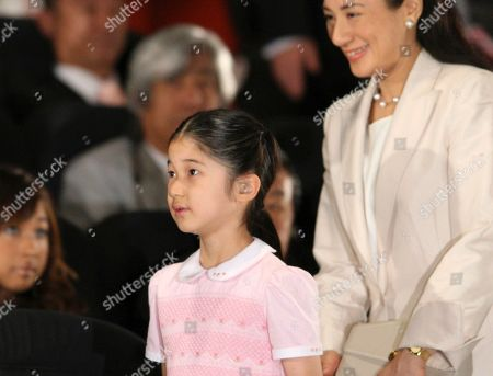 """Aiko, Masako Japanese Princess Aiko, left, and her mother Crown Princess Masako, arrive at a theater for a preview of """"Hachi: A Dog's Story,"""" in Tokyo . The film, starring Richard Gere, is a Hollywood remake of Japan's long-cherished story of Hachiko, the faithful dog that died at a train station waiting for its master"""