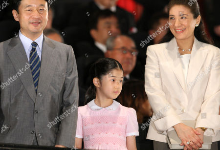 """Naruhito, Aiko, Masako Flanked by her parents, Crown Prince Naruhito, left, and Crown Princess Masako, Princess Aiko arrives at a theater for a preview of """"Hachi: A Dog's Story,"""" in Tokyo . The film, starring Richard Gere, is a Hollywood remake of Japan's long-cherished story of Hachiko, the faithful dog that died at a train station waiting for its master"""