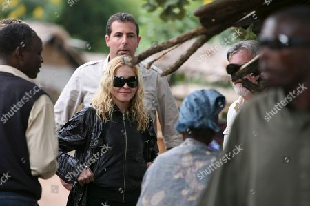 "Stock Image of U.S. pop star Madonna visits Salaza village near Lilongwe, Malawi Friday, April, 3, 2009. In a surprise move, a judge on Friday rejected Madonna's request to adopt a second child from Malawi and said it would set a dangerous precedent to bend rules requiring that prospective parents live here for some period. The country's child welfare minister had come out Thursday in support of the pop superstar's application to adopt 3-year-old Chifundo ""Mercy"" James"