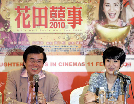 """Raymond Wong, Sandra Ng Hong Kong actress Sandra Ng, right, speaks to media as Hong Kong actor Raymond Wong smiles during a press conference to promote their new Chinese New Year film """"All's Well End's Well Too 2010"""" in Petaling Jaya, near Kuala Lumpur, Malaysia"""